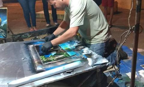 Pinturas com spray e fogo fazem sucesso no Porto do Baé em Barra do Garças
